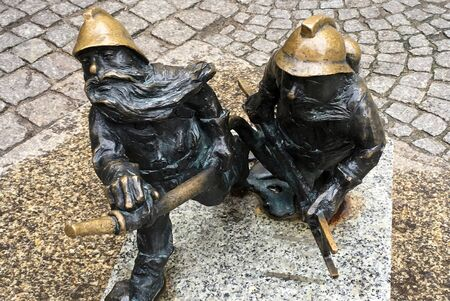 Small bronze statue Wroclaw dwarfs in the streets of the Polish city Wroclaw - Poland.