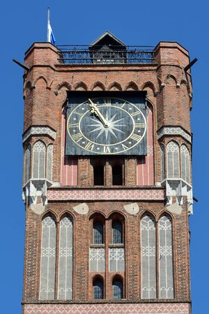 Tower of the City hall on the market place Rynek Staromiejski inTorun - Poland.