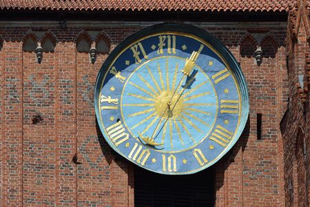 Clock of the Cathedral of Saint John the Baptist and Saint John the Evangelist in the old city of Torun - Poland. Stock Photo