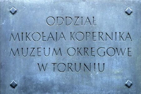 Information board at the birth house of the astronomer and mathematican Nicolaus Copernicus with the Copernicus Museum in Torun - Poland.