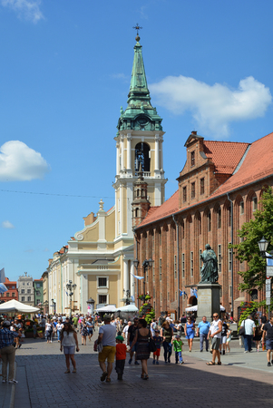 Old Town hall and Holy Spirit Church on the market place Rynek Staromiejski in Torun - Poland.