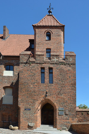 Entrance of the Citizen Court at the city wall in Torun - Poland. Editorial