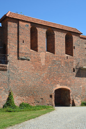 Old city wall of Torun with a defence tower from the 13th century - Poland. Editorial