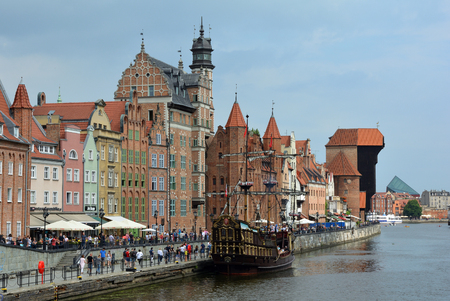 Cityscape of Gdansk at the river Motlawa with Crane gate and Old sailing ship - Poland.