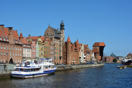 Cityscape of Gdansk at the river Motlawa with Crane gate and Passenger liner - Poland.