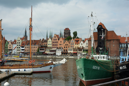 Cityscape of Gdansk at the river Motlawa with the tower of the Church Saint Mary and Crane gate - Poland. Editorial
