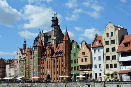 Cityscape of Gdansk at the river Motlawa with the Saint Marys gate - Poland.