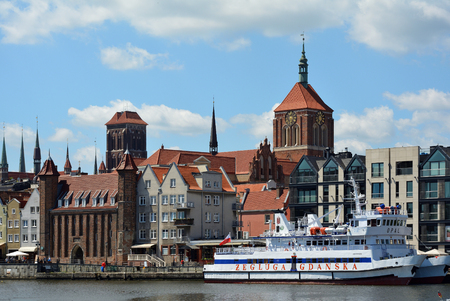 Cityscape of Gdansk at the river Motlawa with the tower of the Church Saint Mary and Church Saint John - Poland.