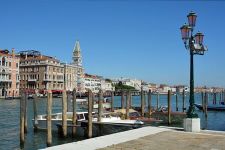 View over the Grand Canal on San Marco with the clock tower Campanile of Venice - Italy.