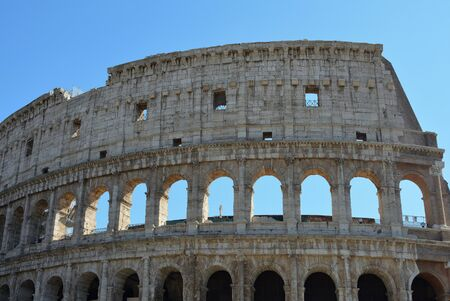 Colosseum at the Piazza del Colosseo in Rome - Italy.