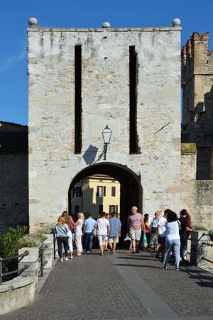 Entrance to the Scaligero castle in the historic center of Sirmione on Lake Garda - Italy.