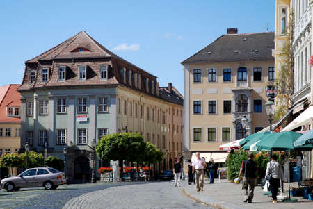 Pedestrians on the Market place at the Town hall of Zittau in Saxony - Germany.