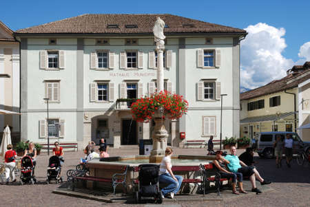 City hall of Kaltern at the South Tyrolean wine route with the Marienbrunnen on the market place - Italy.