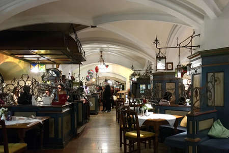 Traditional restaurant Ratskeller in the New Townhall of Bavarian capital Munich - Germany.