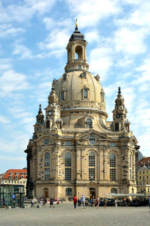 Tourists at the Church of Our Lady on the New Market of Dresden - Germany.