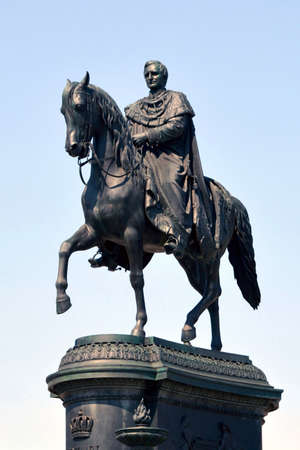 Equestrian statue of the saxon King Johann in front of the opera house Semperoper on the Theater square in Dresden - Germany.