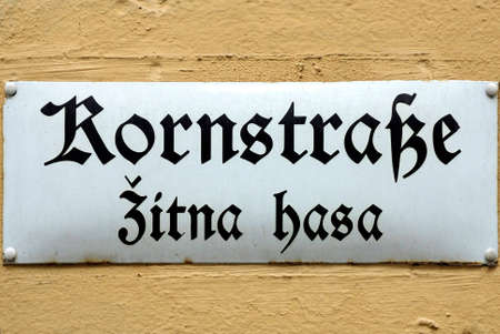Bilingual road sign in German and Sorbian language at the Main market of Bautzen in the Upper Lusatia in Saxony - Germany. Редакционное