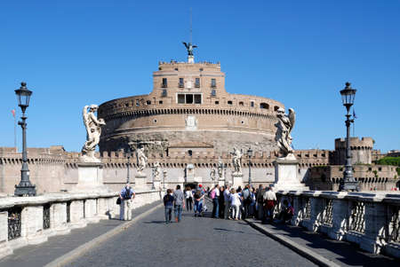 Angel castle with the Angel bridge at the Tiber in Rome - Italy. Редакционное