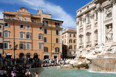 Trevi fountain in Piazza di Trevi in Rome visited by tourists - Italy.