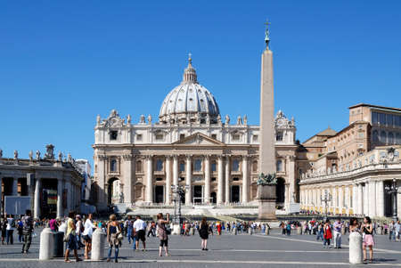 People in Saint Peters square in front of Saint Peters Basilica at the Vatican in Rome - Italy.