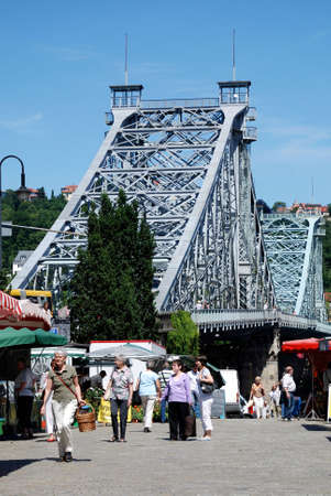 People at the Bridge Loschwitzer Bruecke of Dresden at the river Elbe in Saxony. - Germany.