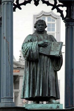 Monument for the reformer Martin Luther on the market place in front of the old city hall of Wittenberg - Germany. Редакционное