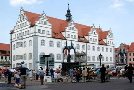 People in the town square of Wittenberg on the Old Town Hall with the memorial to Luther and Melanchthon. - Germany. Редакционное