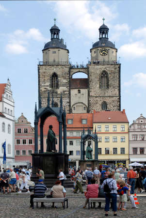 Market place of Wittenberg with the church Saint Marien and the memorials for Martin Luther and Philipp Melanchthon - Germany. Редакционное