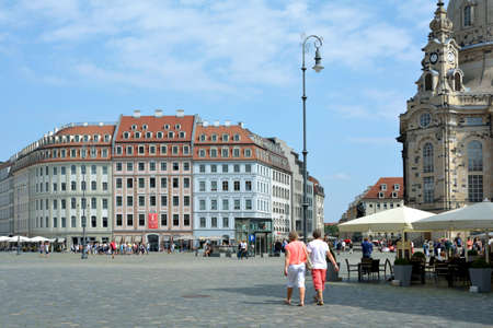 Tourists on the New Market in Dresden before the townhouses - Gerrmany.