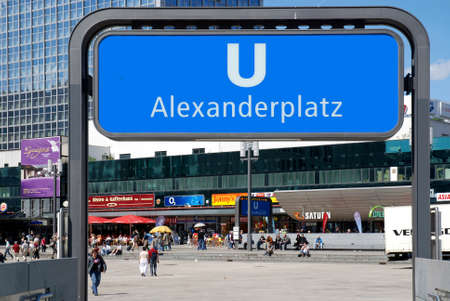 Entrance to the subway station at Alexanderplatz in Berlin with people - Germany. Redactioneel
