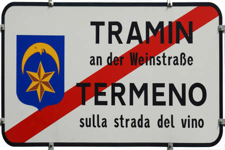 Place name sign of the Municipality of Tramin at the South Tyrolean Wine street in Italy - Italy.