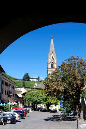 View of the town center of Tramin at the South Tyrolean wine route at Bolzano with the Parish church - Italy.