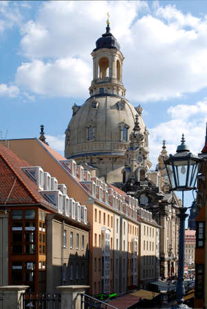 Look at the rebuilt Frauenkirche from Bruehl's terrace over the houses in the coining lane on the New market in Dresden - Germany. Redactioneel