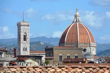 View of the dome of the Cathedral of Santa Maria del Fiore with Giotto's campanile in Florence - Italy.