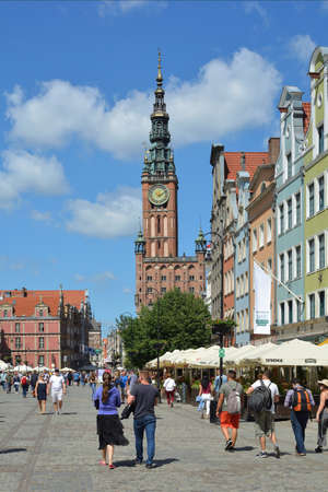 Old town of Gdansk with pedestrians in the Long market with view of the Town hall - Poland.