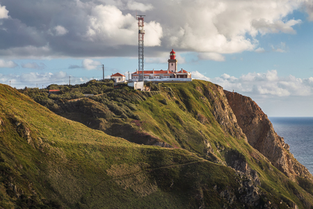 rock formation: The lighthouse in Cabo da Roca. Cliffs and rocks on the Atlantic ocean coast in Sintra in a beautiful spring day, Portugal