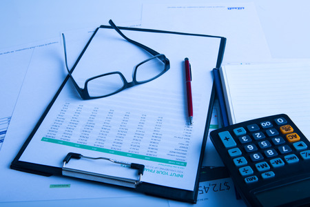 statements: Financial statements glasses and calculator