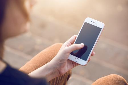 woman's hand using smart phone