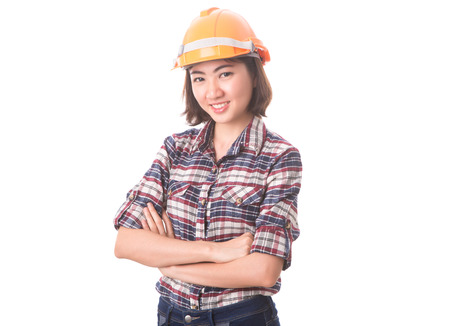 Smiling confident woman builder architect standing with crossed arms. Studio isolated portrait.
