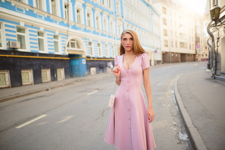 Fashionably dressed woman walk on the streets