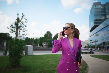 Young beautiful business woman talking on the phone. Business concept