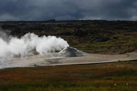 Soaring geyser in a zone of volcanic activity in Iceland photo