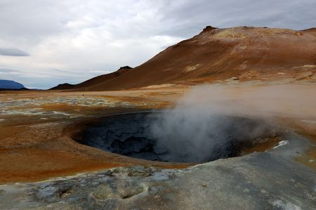 a geyser in a zone of volcanic activity in Iceland photo