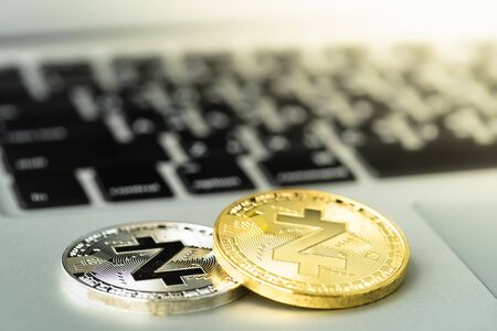 Zcash (ZEC) Coin on notebook. Bitcoin security. digital cyber safety or security encryption.