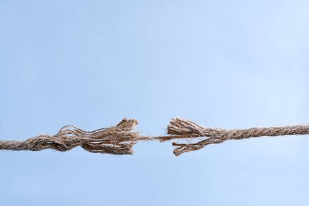Stress and risk concept. Rope frayed in tension.