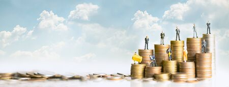 Miniature people standing on stack of coins. Inequality and social class. Income and economic inequality concept. Inequality in social class, ideology, Gender, Racial and ethnic and health. Banque d'images
