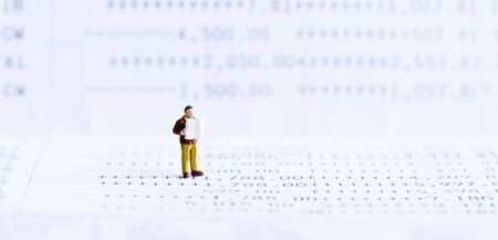 Miniature people: Businessman standing on bank passbook. retirement planning and pension. Money saving and Investment. Inequality and social class. Income and economic inequality concept.