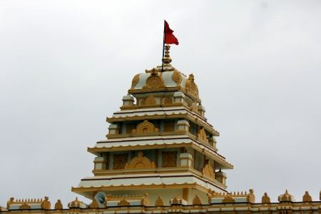 pune: Temple top with red flag in Hadshi from Pune Stock Photo