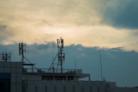 antennae: Siluate wifi and internet antenna on the building with sky background