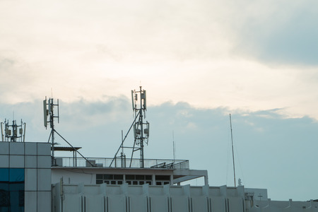 parable: Wifi and internet antenna on the building with sky background
